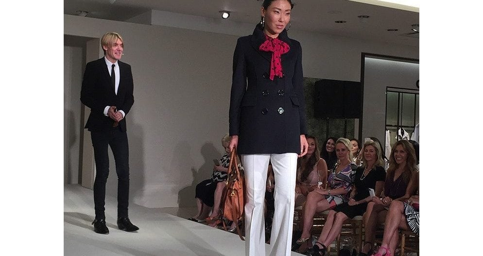 """White flared pants and a navy cashmere coat. A nod to Mary Tyler Moore."""