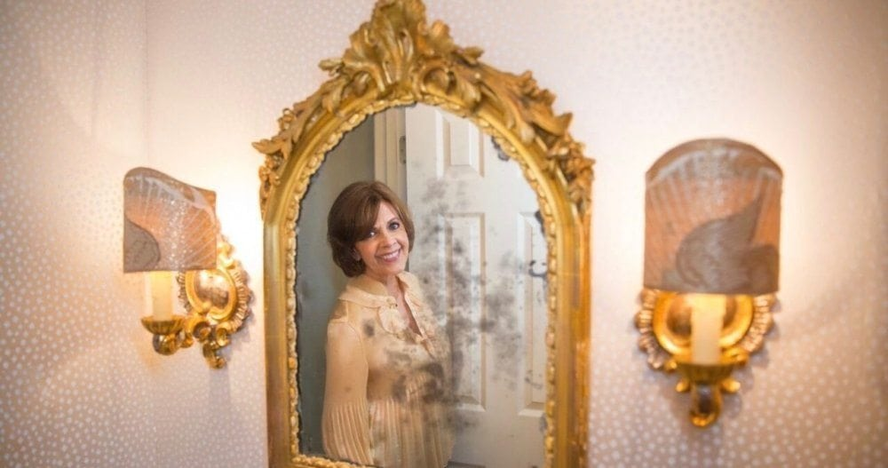 BRENDA COFFEE REFLECTED IN HER POWDER ROOM MIRROR. PHOTOGRAPHS © JENNIFER DENTON, 2017.