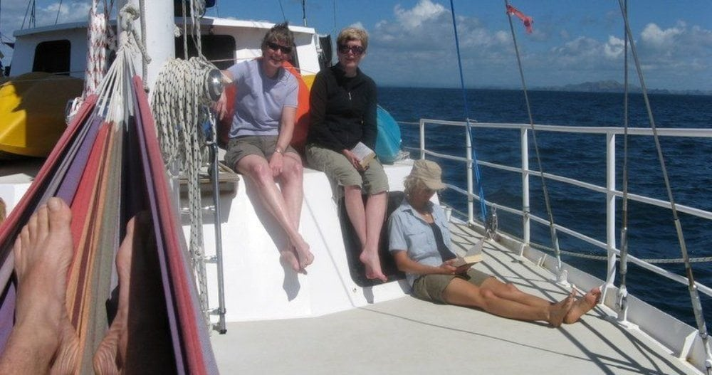 SUE BURPEE AND HER HUSBAND ON A SAILING ECO-CRUISE IN NEW ZEALAND.