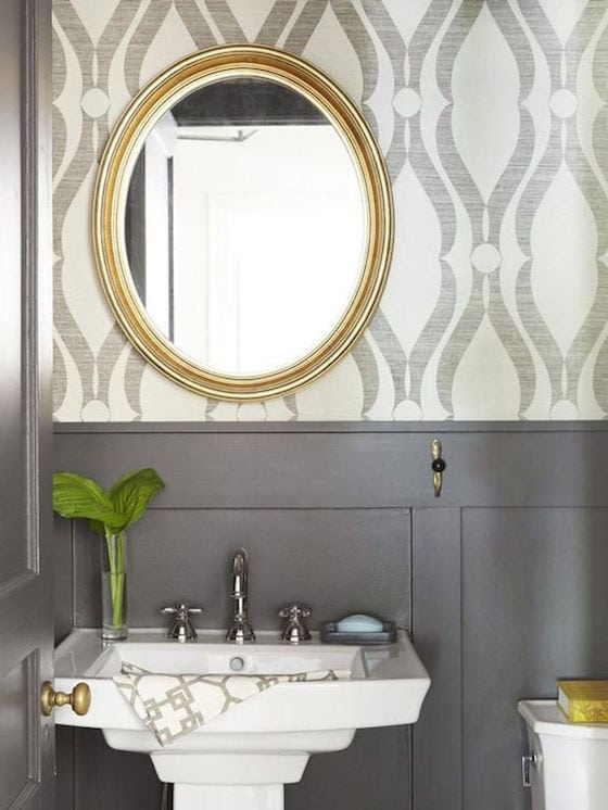Gray and white wallpapered powder room