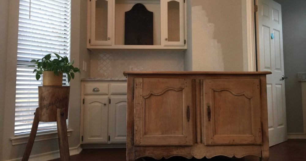 Removing the upper glass cabinets, marble backsplash and the lower cabinets topped with marble.