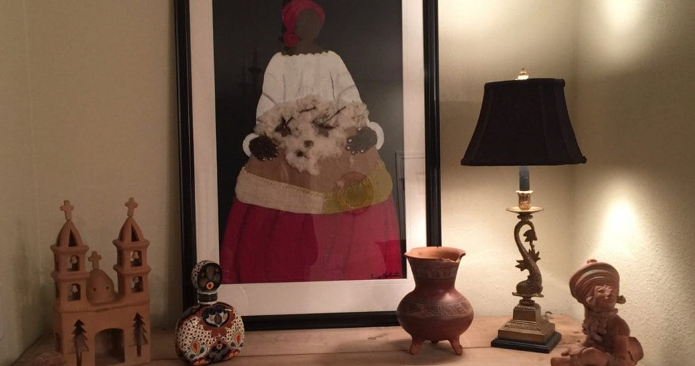 So many things from my life are reflected in this house: when I dug for Mayan artifacts and my love for folk art. This framed, mixed media piece is by Jackie Haliburton.