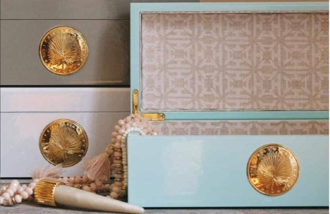 """Treasure Boxes for all of your lovely booty. Lined with heritage printed linen. The front is a gold palm coin reminding us every day to """"Live an Extraordinary Life."""""""