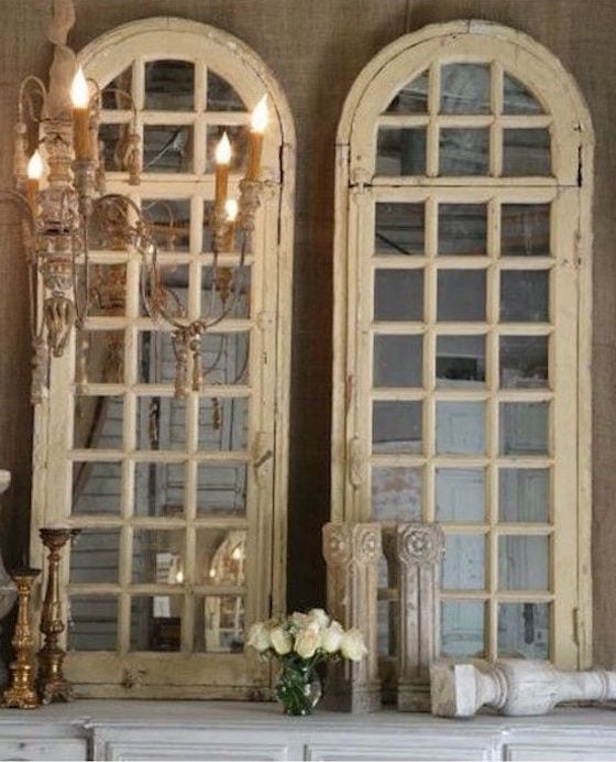Old arched windows backed with mirrors